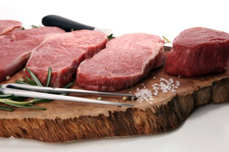 Photo for Steak raw. Barbecue Rib Eye Steak, dry Aged Wagyu Entrecote. Variety of Raw Black Angus Prime meat steaks Machete, Striploin, Rib eye, Tenderloin fillet mignon - Royalty Free Image