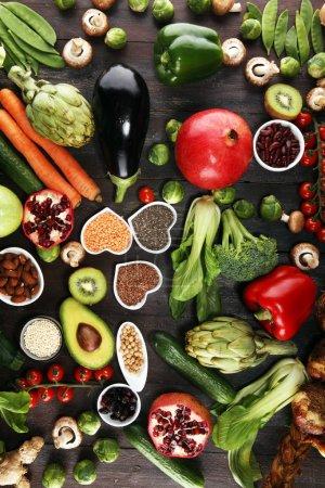 Photo for Healthy food clean eating selection. fruit, vegetable, seeds, superfood, cereals, leaf vegetable. veggie or vegan food - Royalty Free Image