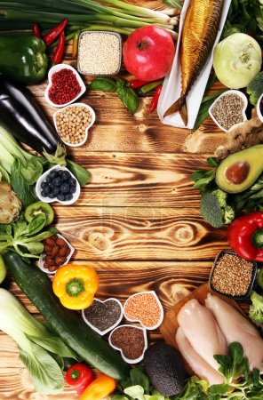 Photo for Healthy food clean eating selection. fruit, vegetable, seeds, superfood, cereals, leaf vegetable and fish and chicken. - Royalty Free Image