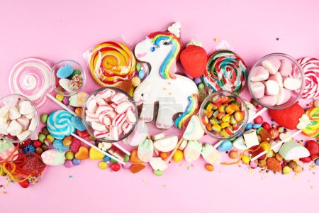 Photo for Candies with jelly and sugar. colorful array of different childs sweets and treats on pink background - Royalty Free Image