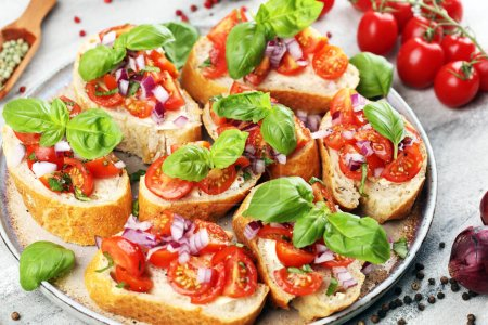 Photo for Fresh tomato bruschetta. italian food appetizer with basil on rustic table - Royalty Free Image