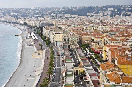 Photo for NICE, FRANCE - JUNE 3: Promenade des Anglais and city of Nice on June 3, 2013 - Royalty Free Image