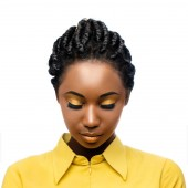 Macro close up beauty portrait of black woman looking down with eyes closed.Girl with stylish braided hairstyle and professional make up isolated on white background.