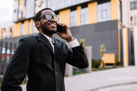 Photo for Portrait of a young businessman talking on the phone - Royalty Free Image