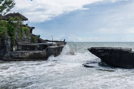 Scenic view of Tanah Lot Temple, ocean and cloudy sky, bali, indonesia
