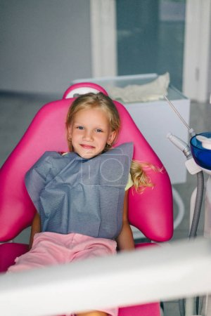 portrait of smiling kid looking at camera at dentist office