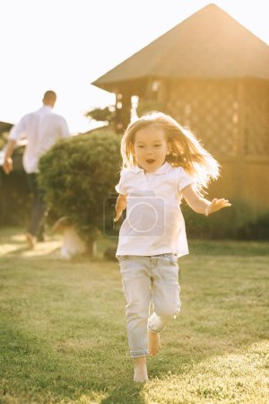 Photo for Happy little kid having fun on yard on summer day - Royalty Free Image
