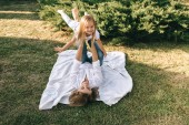 mother and cute little daughter having fun together on backyard