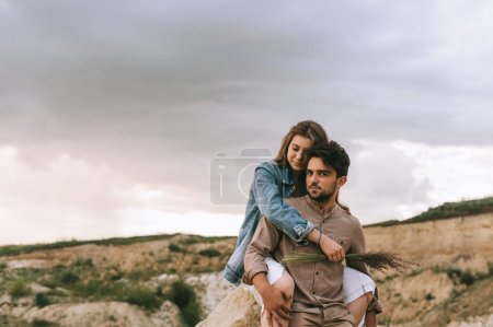 Photo for Handsome boyfriend piggybacking his girlfriend, love story - Royalty Free Image