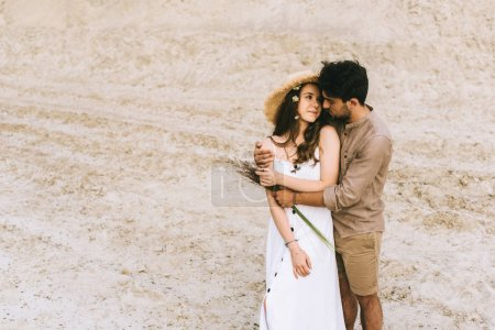 Photo for Happy young stylish couple hugging in sand canyon - Royalty Free Image