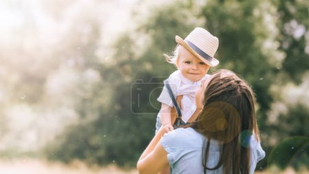 mother holding adorable little son on hands