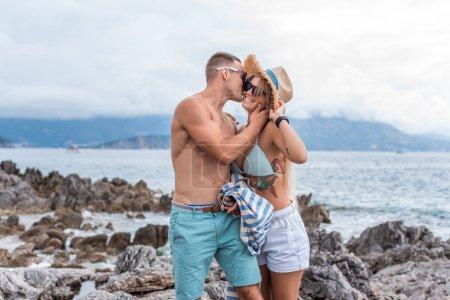 boyfriend kissing girlfriend at beach in Montenegro