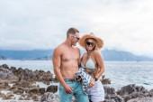 smiling girlfriend and boyfriend standing at beach in Montenegro