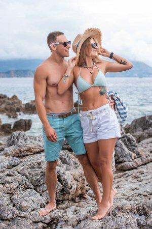 girlfriend and boyfriend looking away at beach in Montenegro