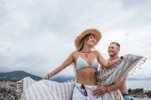 low angle view of beautiful happy young couple spending time together on beach in montenegro