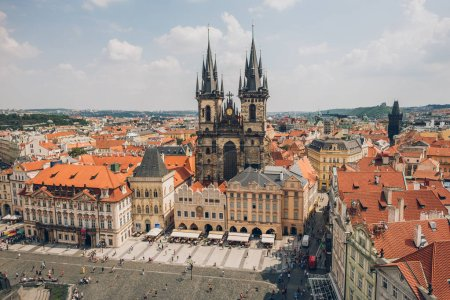 Photo for PRAGUE, CZECH REPUBLIC - JULY 23, 2018: aerial view of famous old town square with tourists and beautiful prague cityscape - Royalty Free Image