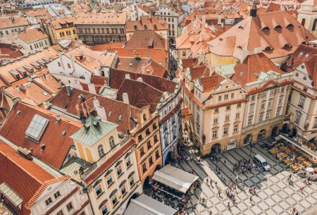 PRAGUE, CZECH REPUBLIC - JULY 23, 2018: aerial view of people on old town square and beautiful architecture in prague, czech republic