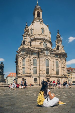 DRESDEN, GERMANY - JULY 24, 2018: people on square near Church of Our Lady in Dresden, Germany