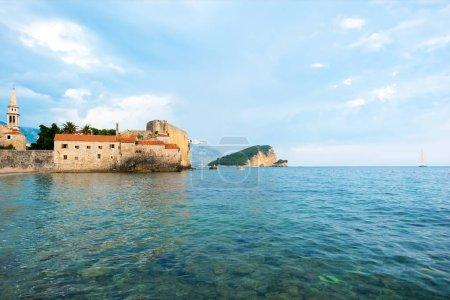 Photo for Bell Tower of Sveti Ivana Cathedral and Adriatic sea in Budva, Montenegro - Royalty Free Image