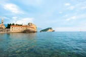 Bell Tower of Sveti Ivana Cathedral and Adriatic sea in Budva, Montenegro