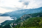 aerial view of Budva riviera, Adriatic sea and mountains in Montenegro