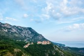 houses on green hill near Budva town in Montenegro