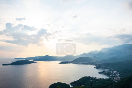 Photo for Aerial view of Budva riviera and Adriatic sea during sunset in Montenegro - Royalty Free Image