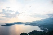 aerial view of Budva riviera and Adriatic sea during sunset in Montenegro
