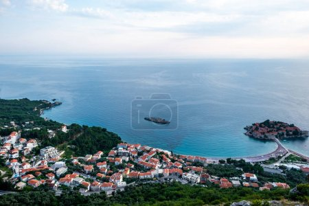aerial view of Budva town and island of Sveti Stefan with hotel resort in Adriatic sea, Montenegro