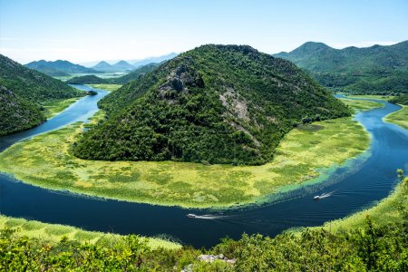 Photo for Landscape of blue curved Crnojevica River and mountains in Montenegro - Royalty Free Image