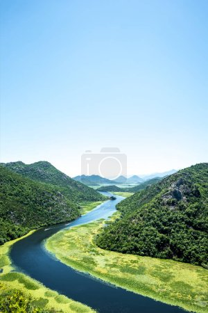 landscape of beautiful Crnojevica River (Rijeka Crnojevica) and mountains in Montenegro