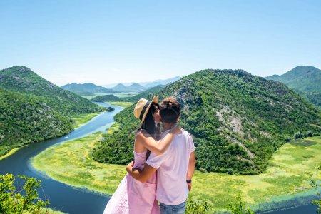girlfriend kissing boyfriend near Crnojevica River (Rijeka Crnojevica) in Montenegro