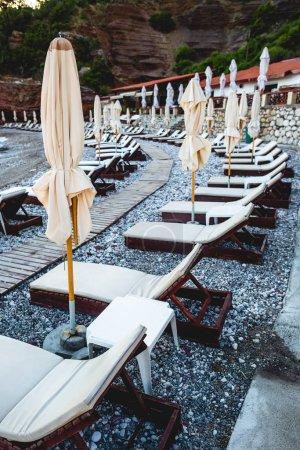 sun loungers on empty beach in Budva, Montenegro