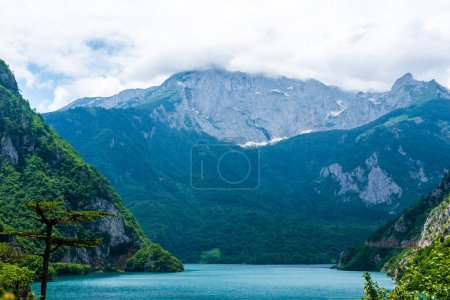 beautiful Piva Lake, mountains and clouds in Montenegro