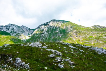 rocky mountains with stones on ground in Durmitor massif, Montenegro