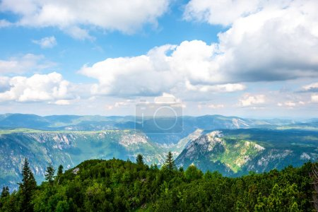 cloudy blue sky above mountains in Durmitor massif, Montenegro