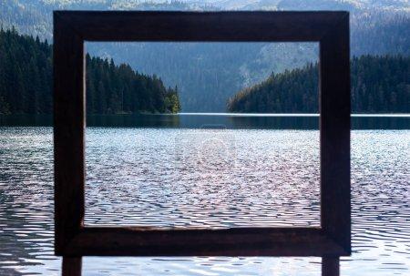 view through frame on beautiful glacial Black Lake in Montenegro