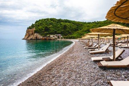 sun loungers on empty beach of adriatic sea in Budva, Montenegro
