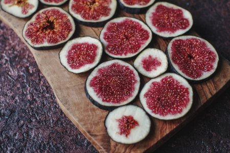 Fresh organic ripe figs on rustic wooden board