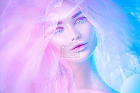 Fashion art portrait model woman in colorful bright neon lights
