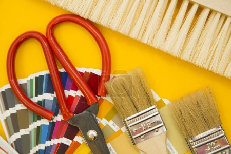 Tools for repair on plain yellow background