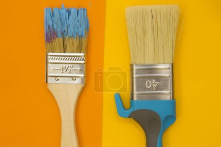 Repair and renovation concept. A set of tools for repair with cans of paint on a yellow background top view, flat lay, copy space
