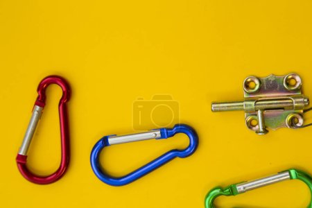 Repair and renovation concept. A set of metal tools for repair with hooks on a yellow background top view, flat lay, copy space