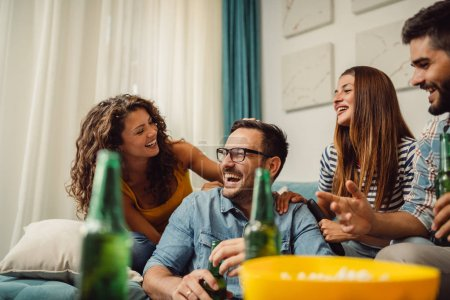 Photo for Portrait of group of friends having fun at home and enjoying together - Royalty Free Image