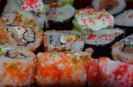 Foto de Overhead japanese sushi food. Rolls with tuna, salmon, shrimp, crab and avocado. - Imagen libre de derechos