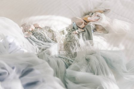 Photo for Stunning delicate wedding dress of the bride embroidered with beads and lace in gray and white colors. Bride's morning - Royalty Free Image