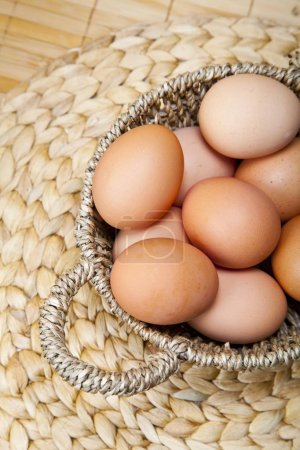 Photo for Organic eggs in a basket - Royalty Free Image