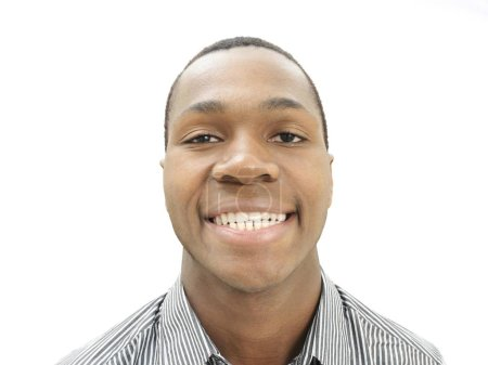 grinning african american man at white background