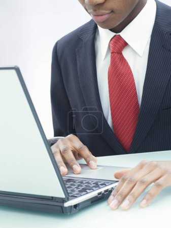Photo for Businessman using laptop in office at table - Royalty Free Image