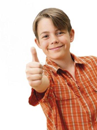 Boy smiling and gesturing thumbs up